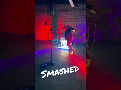 smashing a guitar